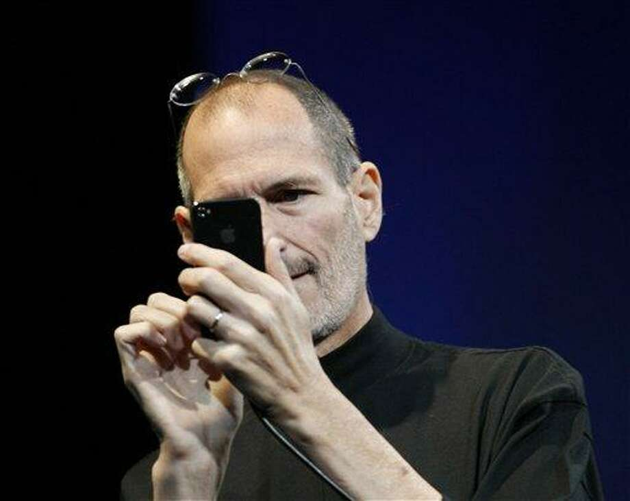 Apple CEO Steve Jobs uses the new iPhone during the Apple Worldwide Developers Conference, Monday, June 7, 2010, in San Francisco. (AP Photo/Paul Sakuma) Photo: AP / AP
