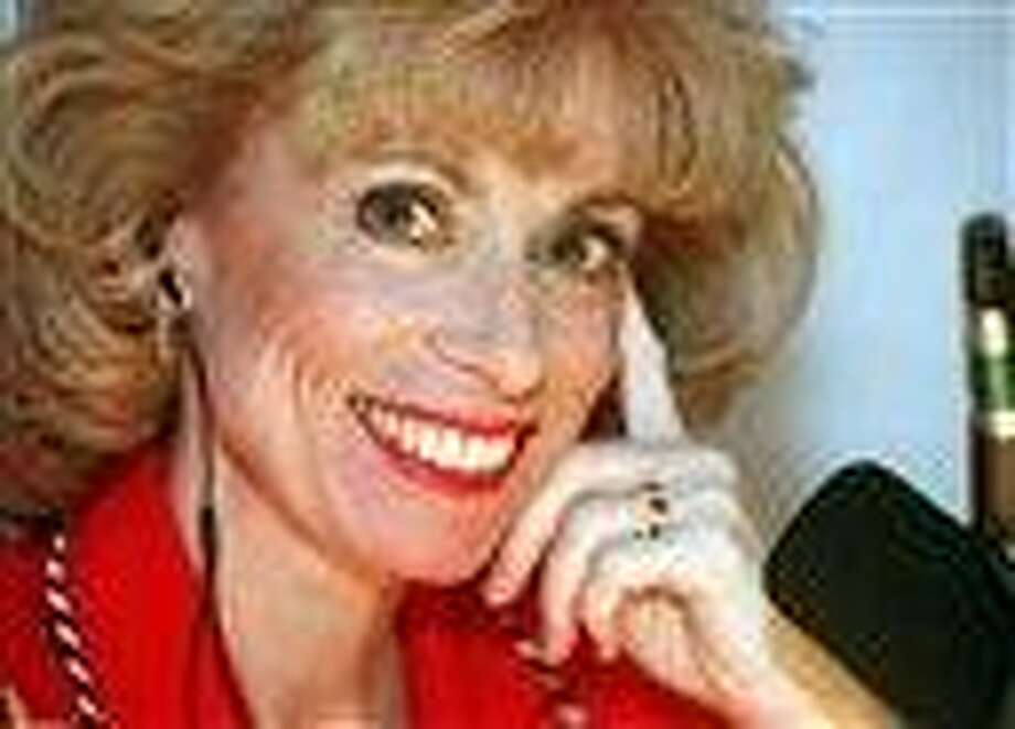 FILE - This Feb. 17, 1998 file photo shows Dr. Laura Schlessinger posing during her morning talk show in her Los Angeles studio.  Schlessinger is apologizing for blurting a racial slur several times during her talk show, Aug. 10, 2010. Schlessinger wrote on her Web site that she was wrong to utter the N-word. (AP Photo/Susan Sterner, File) Photo: AP / AP1998