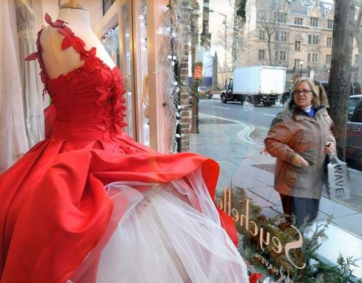 The new retail numbers are out and clothing made big strides over last year at this time. Shopping along Chapel St. in New Haven a passerby looks at the Seychelles holiday window. Photo by Mara Lavitt/New Haven Register12/14/10