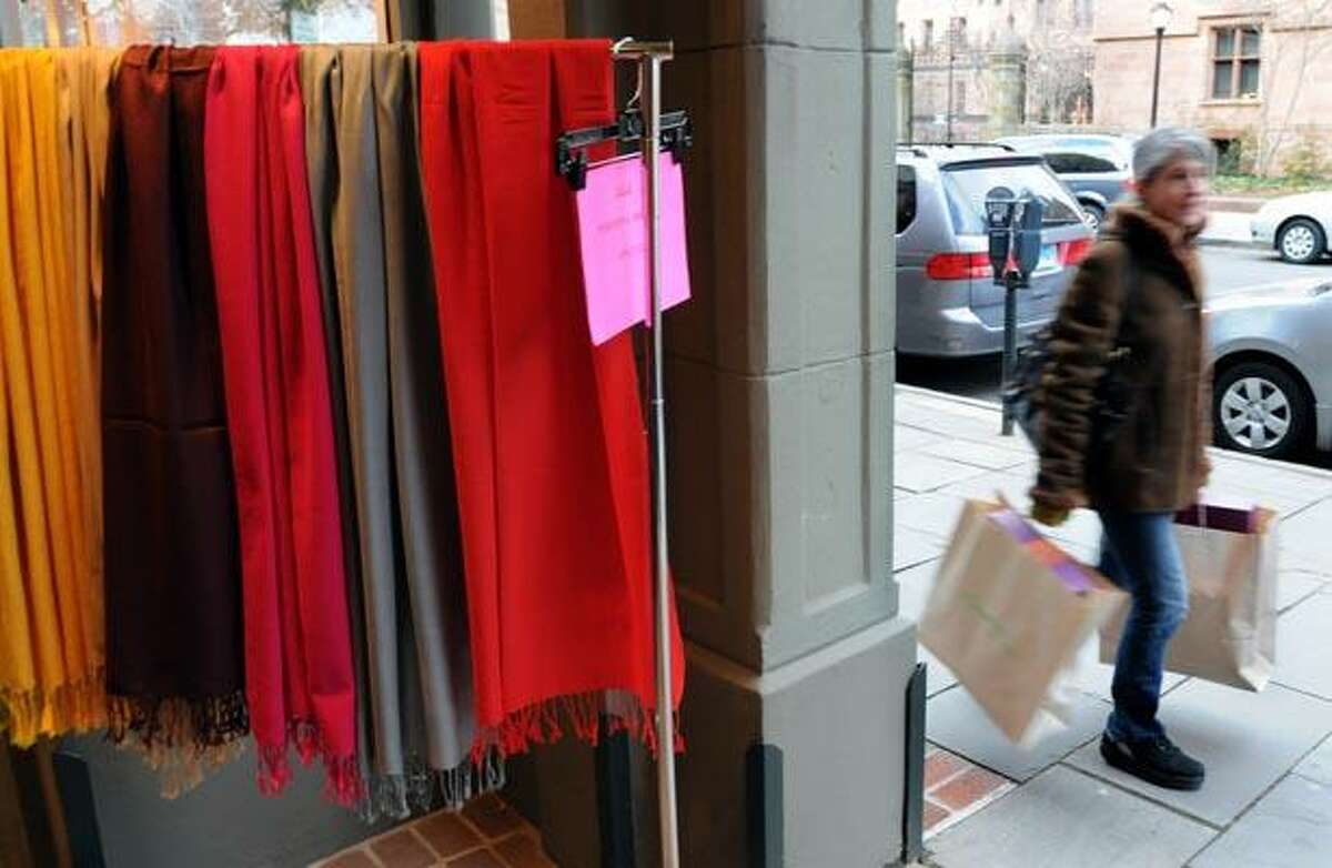 The new retail numbers are out and clothing made big strides over last year at this time. Shopping along Chapel St. in New Haven a shopper passes scarves being sold by Seychelles. Photo by Mara Lavitt/New Haven Register12/14/10