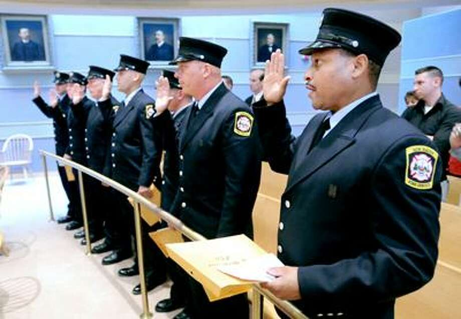 Left to right - Robert Balkun, Mathew Carter, Thomas Connors, Thomas Corrone, Ryan Doherty, Frank Filardo and Theodore Oliver are sworn in during the New Haven Regional Fire Training Academy's 55th Academy Class Graduation at New Haven City Hall on 8/11/2010.Photo by Arnold Gold   AG0380F