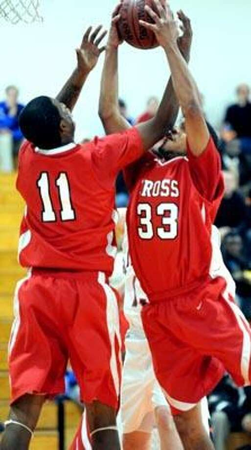 Dontay Long (left) and Kyle Holmes (right) of Wilbur Cross grab a rebound against Lyman Hall in the first half on 12/15/2010.Photo by Arnold Gold/New Haven Register   AG0396A