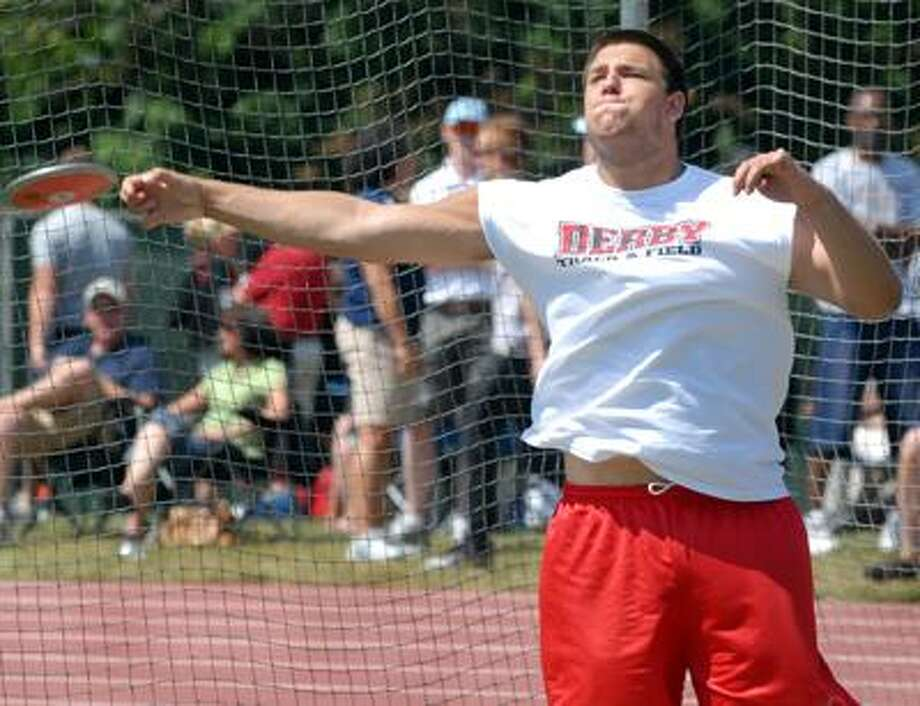 Photography by PETER HVIZDAK   ph2103   #1940New Britain, Connecticut- June 7, 2010:  Enis Bukalo of Derby High School throws the discus and winning  the CIAC State Open Championship  Monday with a distance of 163-02 feet at Veterans' Stadium in  New Britain.