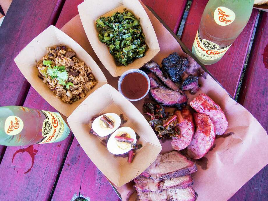 Beef cheeks, housemade beer brats, pork shoulder, deviled eggs, brisket fried rice, collard greens slaw at LeRoy & Lewis Barbecue in Austin. Photo: J.C. Reid