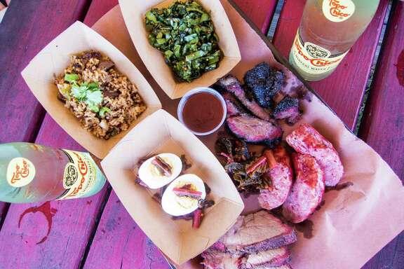 Beef cheeks, housemade beer brats, pork shoulder, deviled eggs, brisket fried rice, collard greens slaw atLeRoy & Lewis Barbecue in Austin.