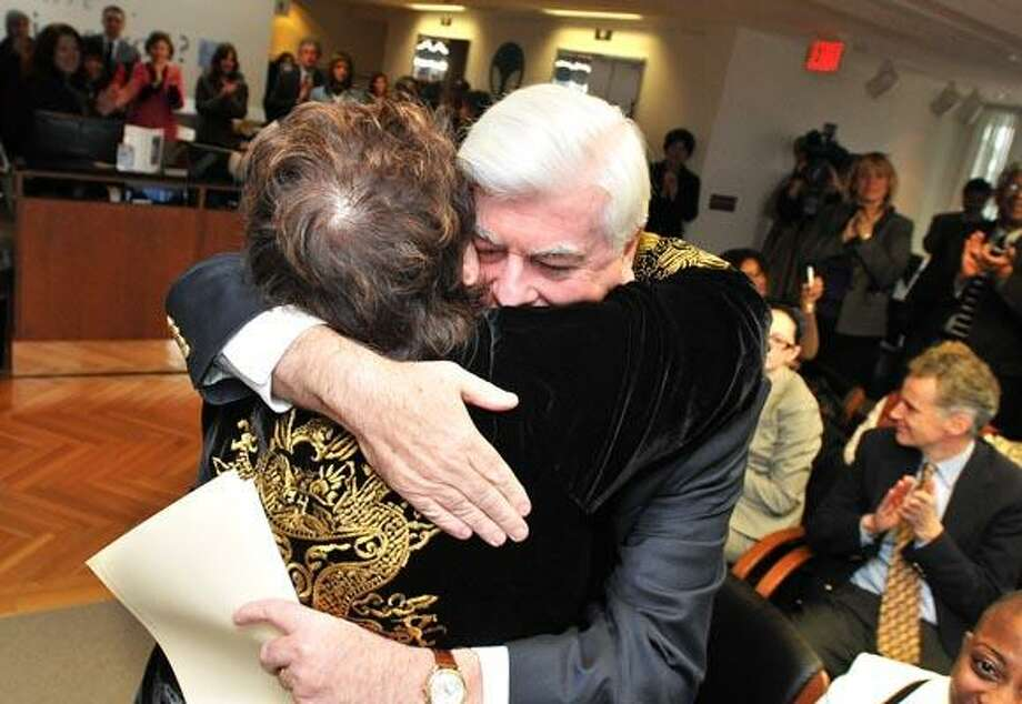 New Haven-- Senator Chris Dodd gets a hug from Patricia Russo, former Chairwoman of the Permanent Commission on the Status of Women, during a ceremony thanking Dodd for his efforts on behalf of women. Dodd was instrumental in the passing of the Family Medical Leave Act. The event was held at the Community Foundation of Greater New Haven. Photo by Peter Casolino/New Haven Register 12/13/10 Cas101213