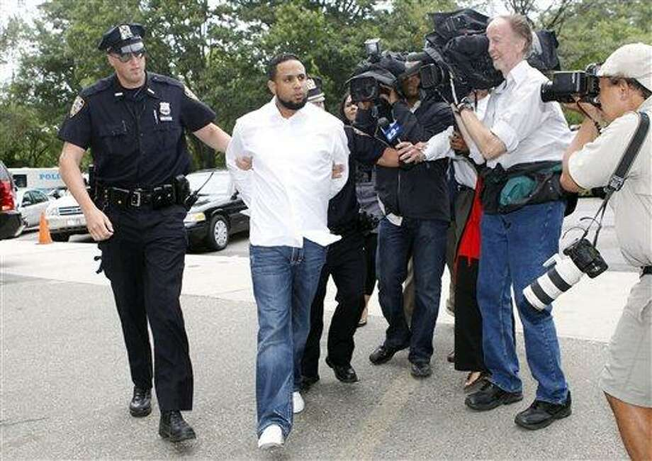 New York Mets baseball pitcher Francisco Rodriguez is led into Queens Criminal Court Thursday, Aug. 12, 2010, in New York. Rodriguez was suspended for two days by the team Thursday, a day after he was charged with assaulting his father-in-law at a Citi Field family lounge following a game. (AP Photo/Jason DeCrow) Photo: AP / FR103966 AP