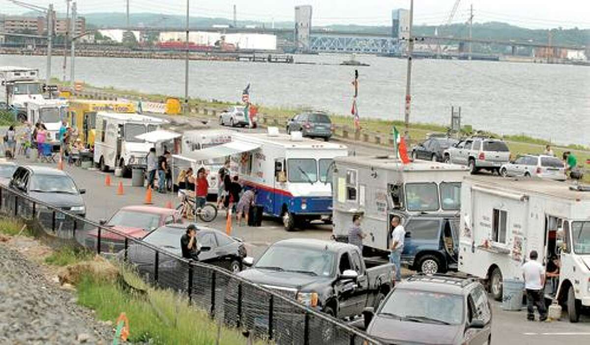 The Interstate 95 redesign has displaced the Long Wharf food trucks from their usual curbside location to a parking lot. Peter Hvizdak/Register
