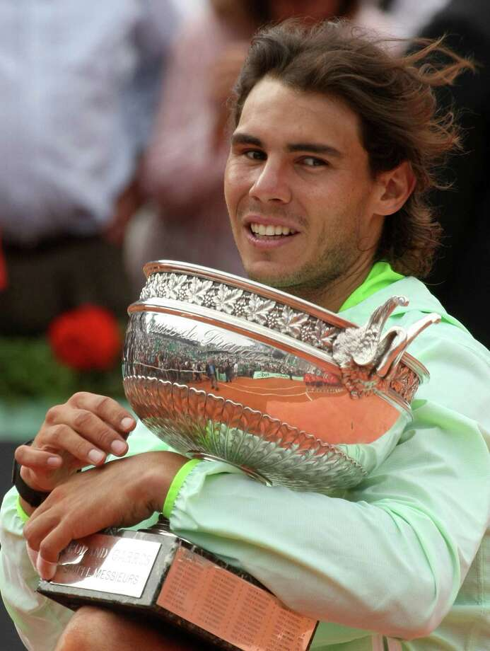 Spain's Rafael Nadal holds the cup after defeating Sweden's Robin Soderling during a men's finals match for the French Open tennis tournament at the Roland Garros stadium in Paris, Sunday, June 6, 2010. (AP Photo/Lionel Cironneau) Photo: ASSOCIATED PRESS / AP2010