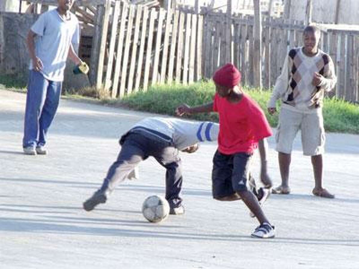 Boys play a game in the township of New Brighton on the outskirts of Port Elizabeth, one of the nine host cities for 2010 FIFA World Cup South Africa. (Mark Zaretsky)