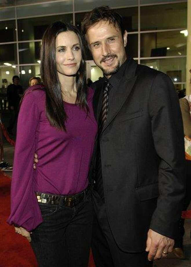 """In this Feb. 28, 2008 file photo, Courteney Cox poses with her husband, David Arquette, at the season two premiere screening of the FX show """"Dirt"""" in Los Angeles. (AP Photo/Chris Pizzello, file) Photo: AP / 2008 AP"""