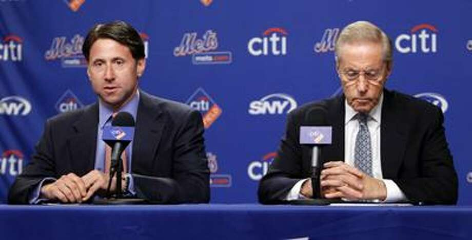 New York Mets owner and CEO Fred Wilpon, right, and COO Jeff Wilpon are in the process of conducting interviews for the vacant general manager position. (AP file photo) Photo: AP / AP