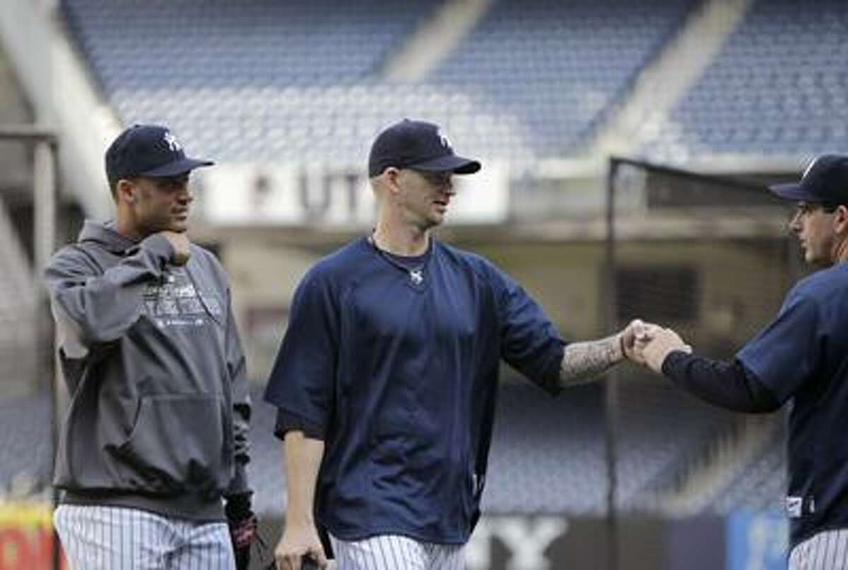 Yankees pitcher A.J. Burnett, center, will get the call in Game 4. (Associated Press/Kathy Willens)