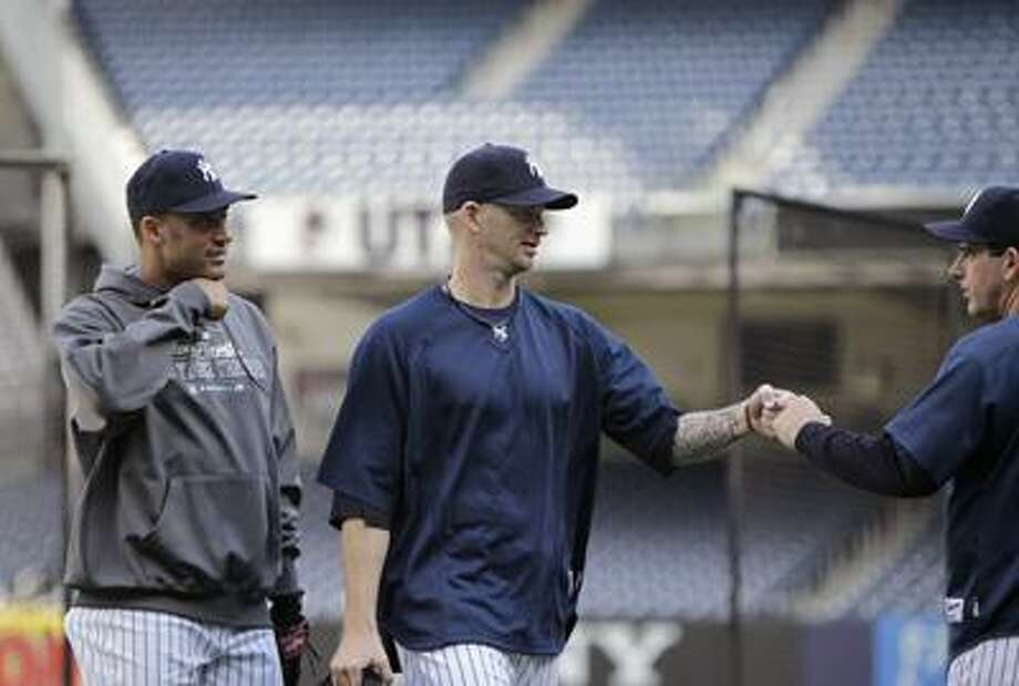 Yankees pitcher A.J. Burnett, center, will get the call in Game 4. (Associated Press/Kathy Willens) Photo: AP / AP