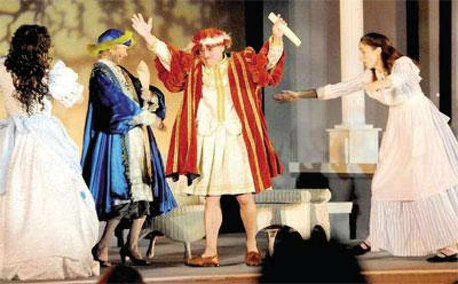 """Guilford First Selectman Joseph Mazza, third from left, and state Rep. Lonnie Reed, D-Branford, second from left, make a cameo appearance in the Shakespeare on the Shoreline production of """"Twelfth Night"""" recently on the Guilford Green. (Peter Hvizdak/Register)"""