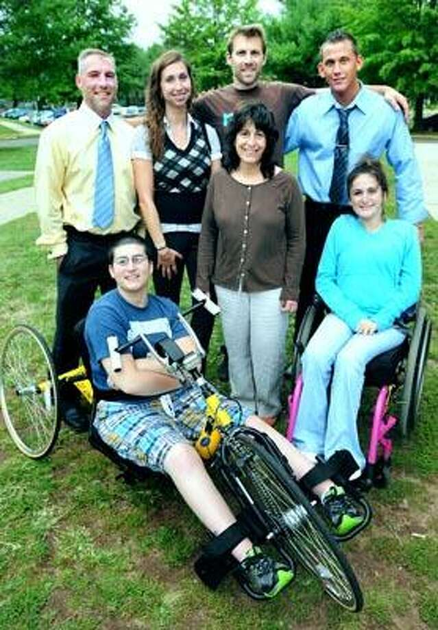 (Back row, left to right) - Rich Walton of Guilford, Mandy Syme of Terryville, Jared Verrillo of Guilford, Chris  Fraenza of North Branford (Front row, left to right) - Sam Bode (on her new hand bike), her mother, Mary Caruso, and sister,  Alex Bode, are photographed at Southern Connecticut State University in New Haven on 9/28/2010. (Arnold Gold/Register)