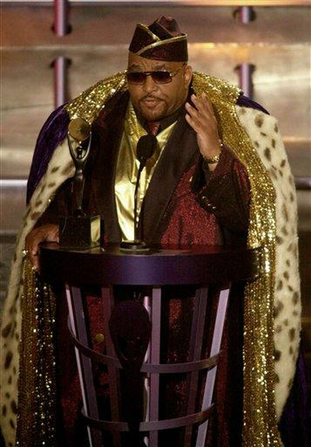 Solomon Burke, one of the pioneers of soul music, gestures to the audience after being inducted into the Rock and Roll Hall of Fame in this March 19, 2001 file photo taken in New York. Burke has died at Amsterdam's Schiphol Airport. Airport police spokesman Robert van Kapel confirmed the death of the singer Sunday Oct. 10, 2010. He was 70. (AP Photo/Kathy Willens)