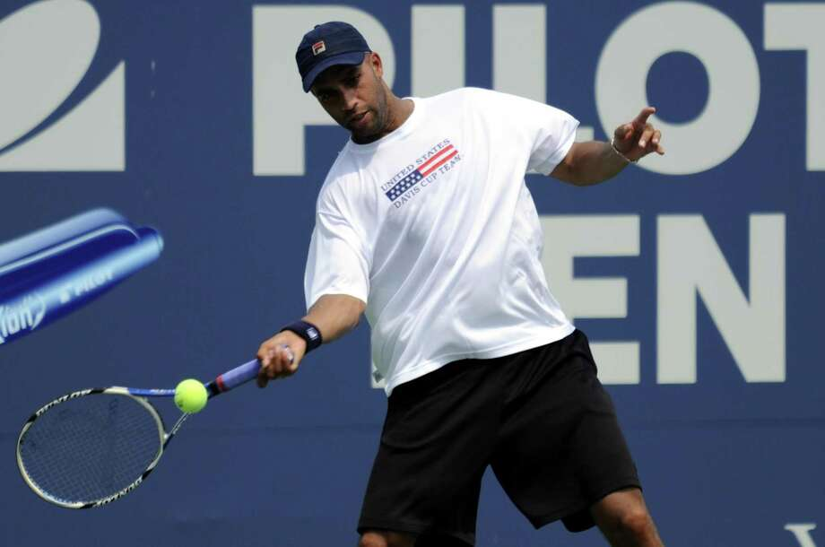 James Blake hits a return to Mardy Fish during a practice session for the Pilot Pen tennis tournament  in New Haven, Conn., Thursday, Aug. 20, 2009.  (AP Photo/Bob Child) Photo: ASSOCIATED PRESS / FR170410AP