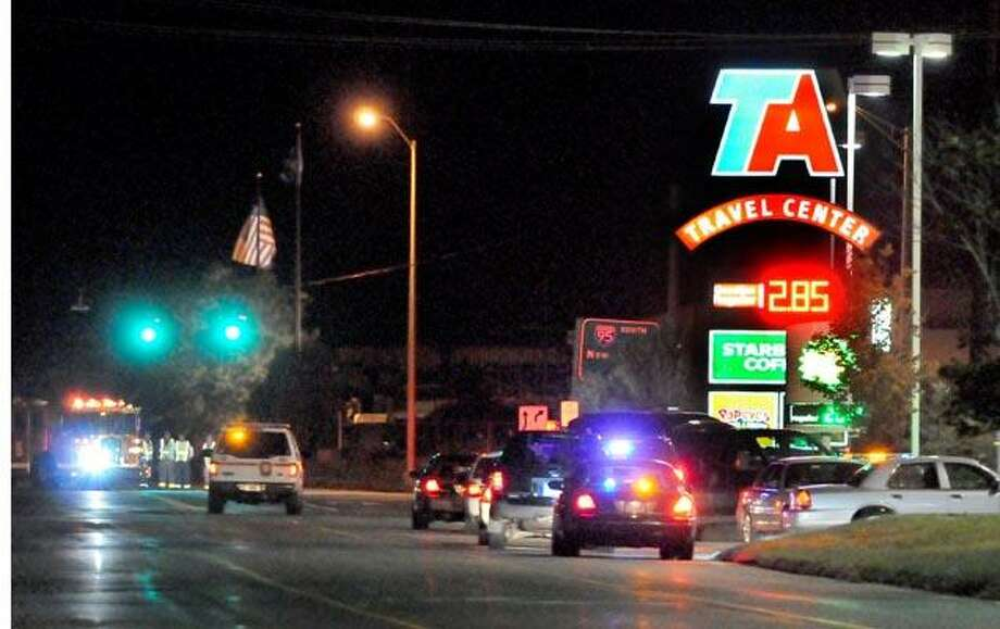 "Law enforcement agencies rushed to the TA Travel Center off I-95 in Branford Friday night when a ""suspicious"" truck was spotted there. (Peter Hvizdak/Register)"