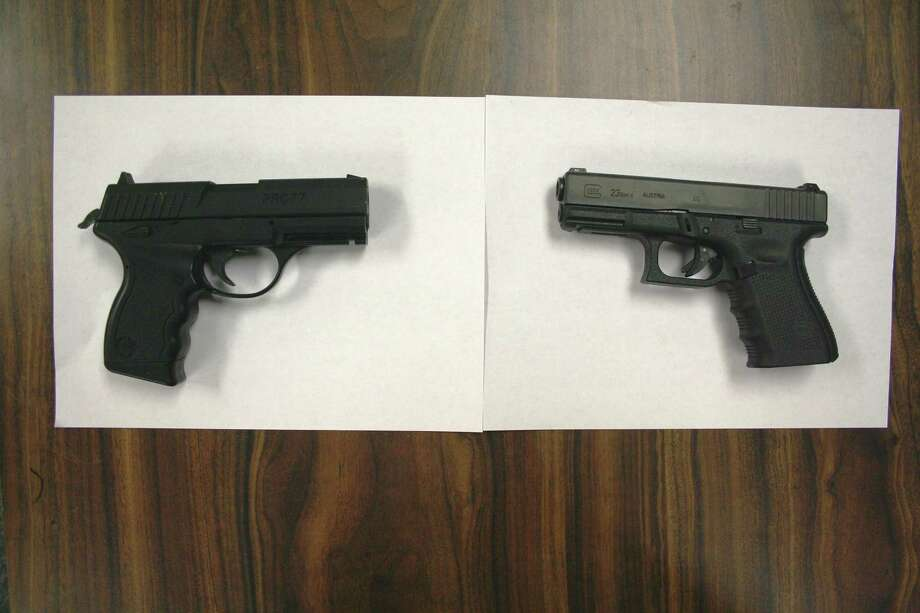 The gun at left is facsimile firearm that was pointed at Officer Katz. At right is a police issued .40 caliber semi-automatic pistol.