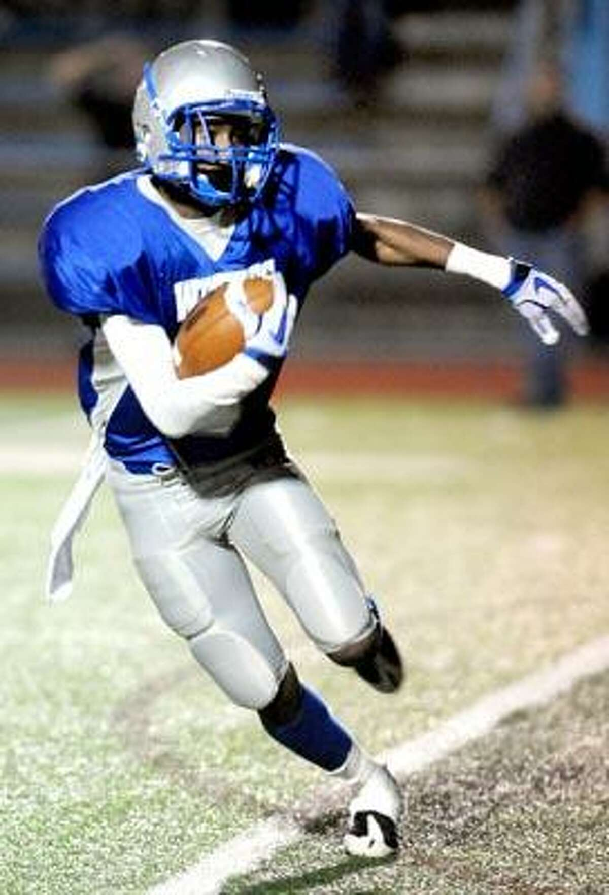 Tremayne Barnes of West Haven finds running room against Notre Dame of West Haven to set up their first touchdown in the first half on 10/8/2010.Photo by Arnold Gold AG0387D
