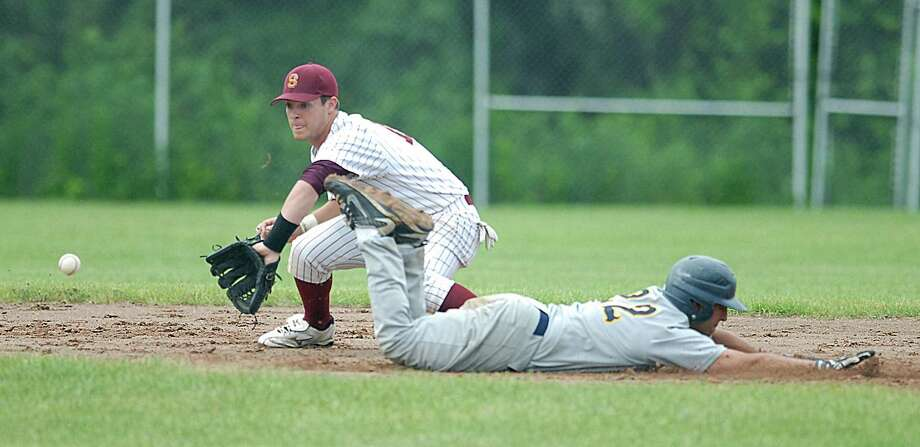 East Haven's Louis Pane slides back into the bag on a pick-off attempt during the Easties' 11-6 loss to Timothy Kiernan and Sheehan Tuesday in the first round of the Class L state tournament. (Peter Casolino/Register)