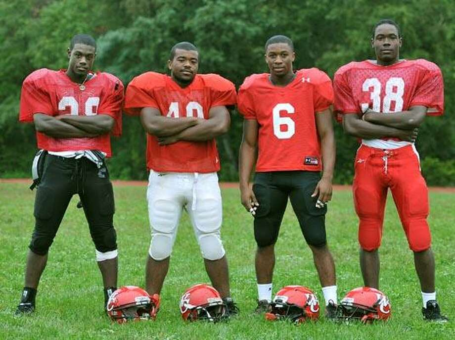 Wilbur Cross captains, from left, Jevon Davis, Terrance McClary, James Ward and Joe Richard. (Peter Casolino/Register)