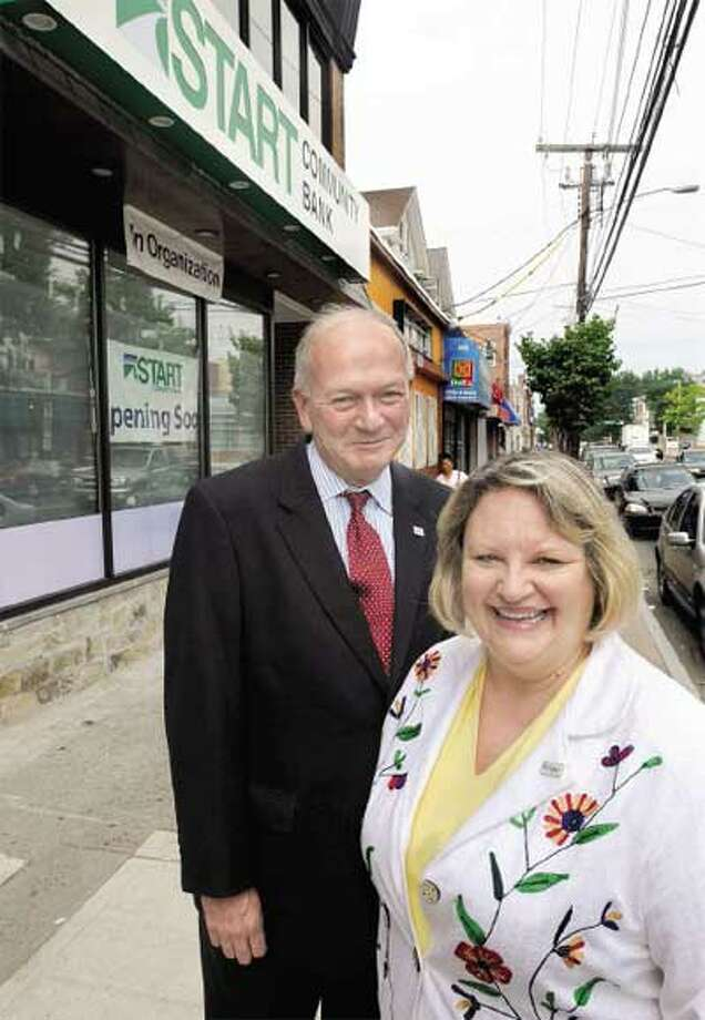 Placke, left, and Smith, right, outside Start Community Bank on Grand Avenue in New Haven's Fair Haven section. (Mara Lavitt/Register)