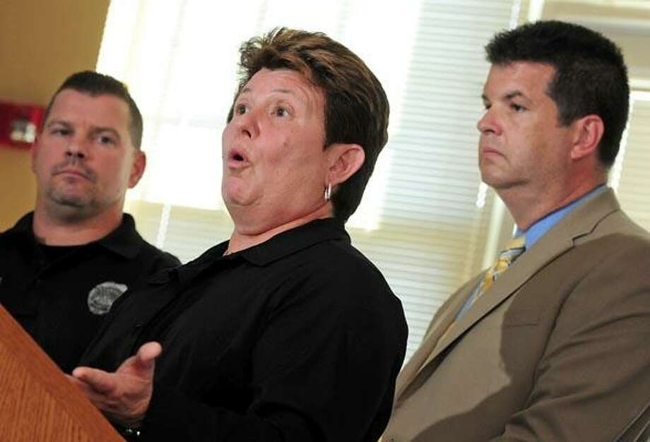 West Haven police Detective Mary Canfield, center, flanked by Officer Bret Schneider, left, and Detective Brian Reilly, speaks about Wednesday's arrest of Alonso Geminiano, during a press conference at police headquarters. (Brad Horrigan/Register)