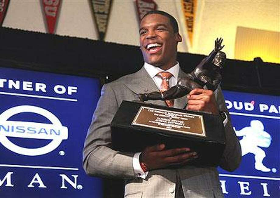 Auburn quarterback Cam Newton reacts during a news conference after winning the Heisman Trophy award, Saturday, Dec. 11, 2010, in New York. (AP Photo/Craig Ruttle)