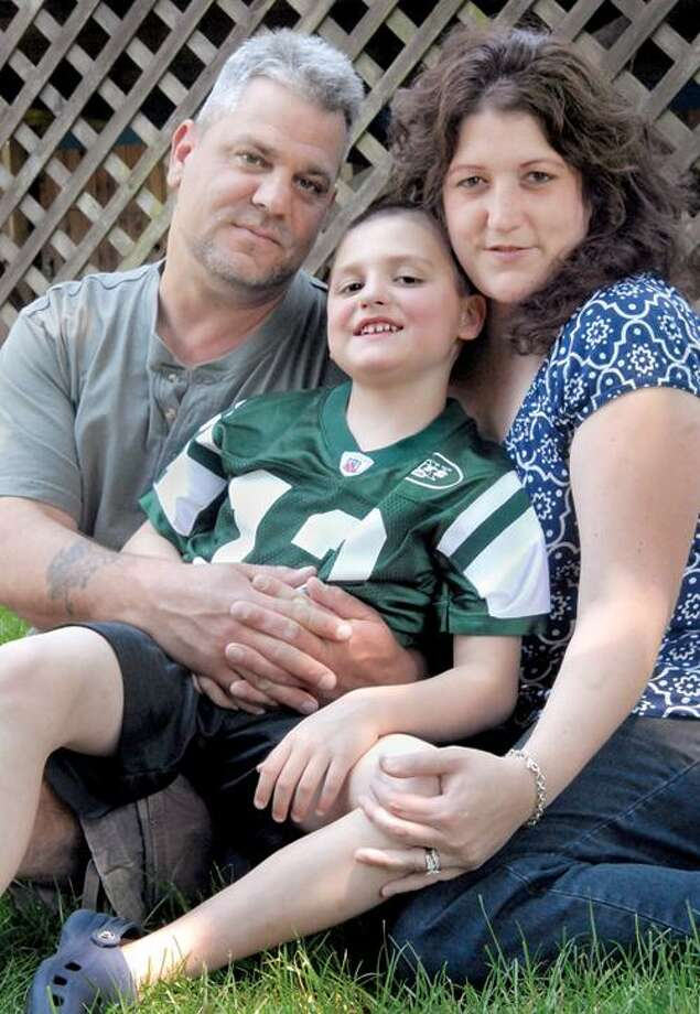 Anthony, and Grace Fortunato with their six year old  son Dylan. Dylan has leukemia. A golf fundraiser will be held in Sept, to raise money for Dylan's medical expenses.   Melanie Stengel/Register