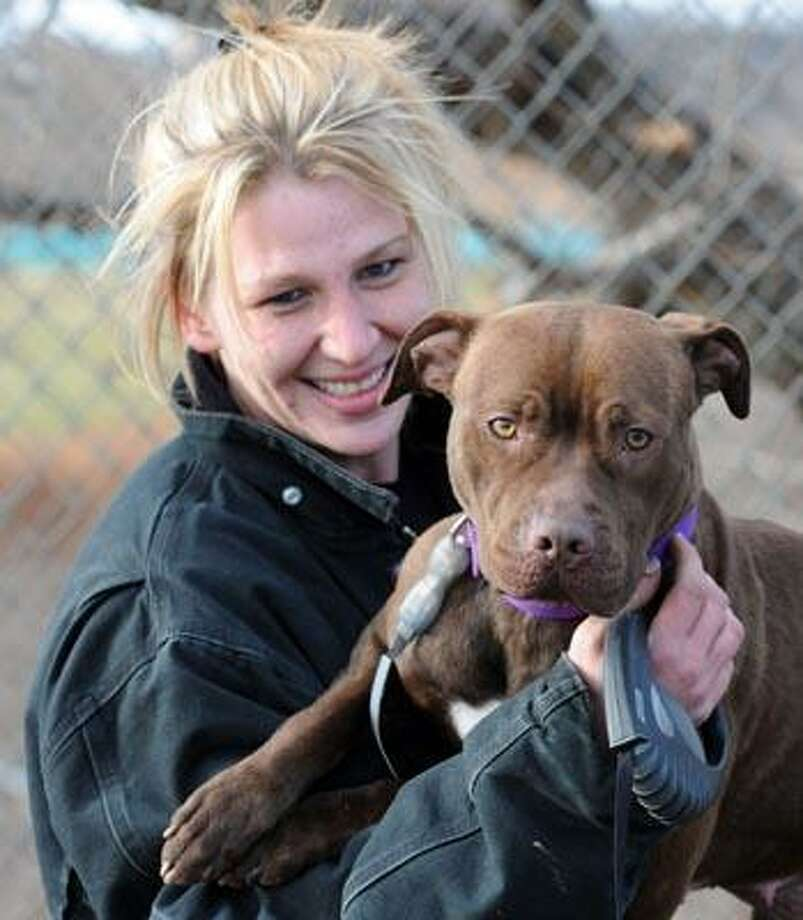 Milford Animal Control animal caregiver Cindy Schultz with Ginger, a pit bull the Shelter is trying to place. (Mara Lavitt/Register)