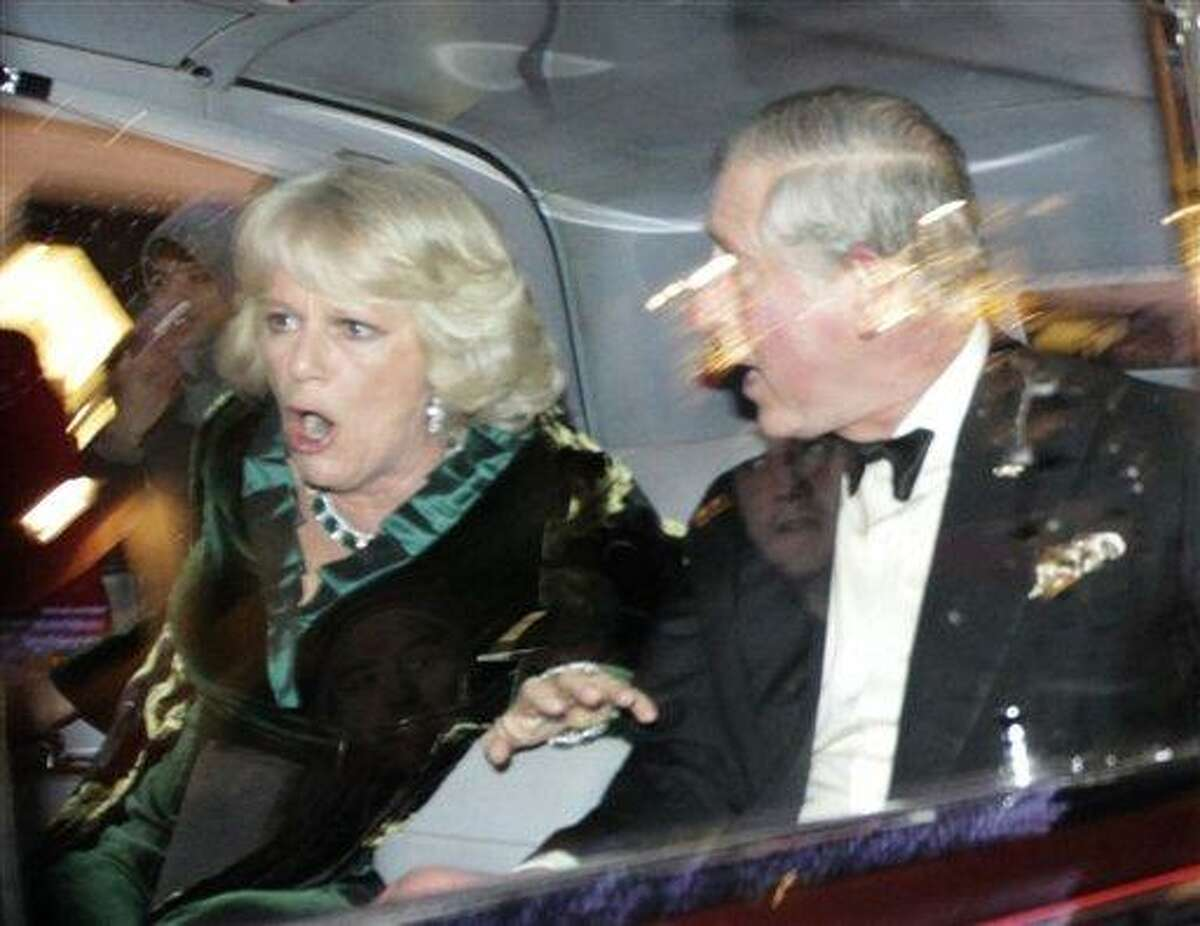 Britain's Prince Charles and Camilla, Duchess of Cornwall, react as their car is attacked by angry protesters in London, Thursday, Dec. 9, 2010. An Associated Press photographer saw demonstrators kick the car in Regent Street, in the heart of London's shopping district. The car then sped off. Charles' office, Clarence House, confirmed that