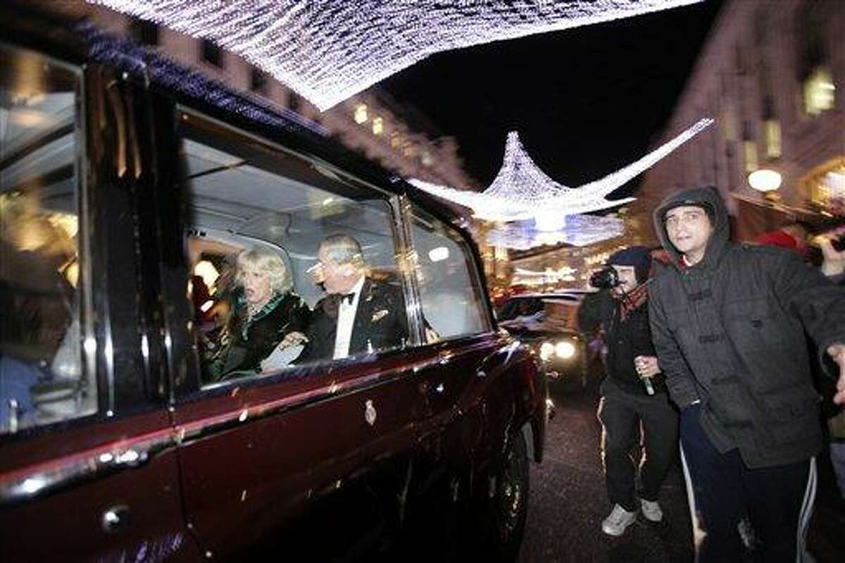 Britain's Prince Charles and Camilla, Duchess of Cornwall react as their car is attacked, in London, Thursday, Dec. 9, 2010. Angry protesters in London have attacked a car containing Prince Charles, the heir to the British throne, and his wife Camilla, Duchess of Cornwall. An Associated Press photographer saw demonstrators kick the car in Regent Street, in the heart of London's shopping district. The car then sped off. Charles' office, Clarence House, confirmed that
