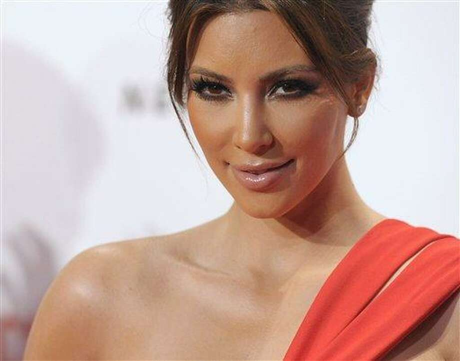 Television personality Kim Kardashian arrives at the LACMA Resnick Exhibition Pavilion grand opening gala in Los Angeles on Saturday, Sept. 25, 2010. (AP Photo/Dan Steinberg) Photo: AP / R-STEINBERG