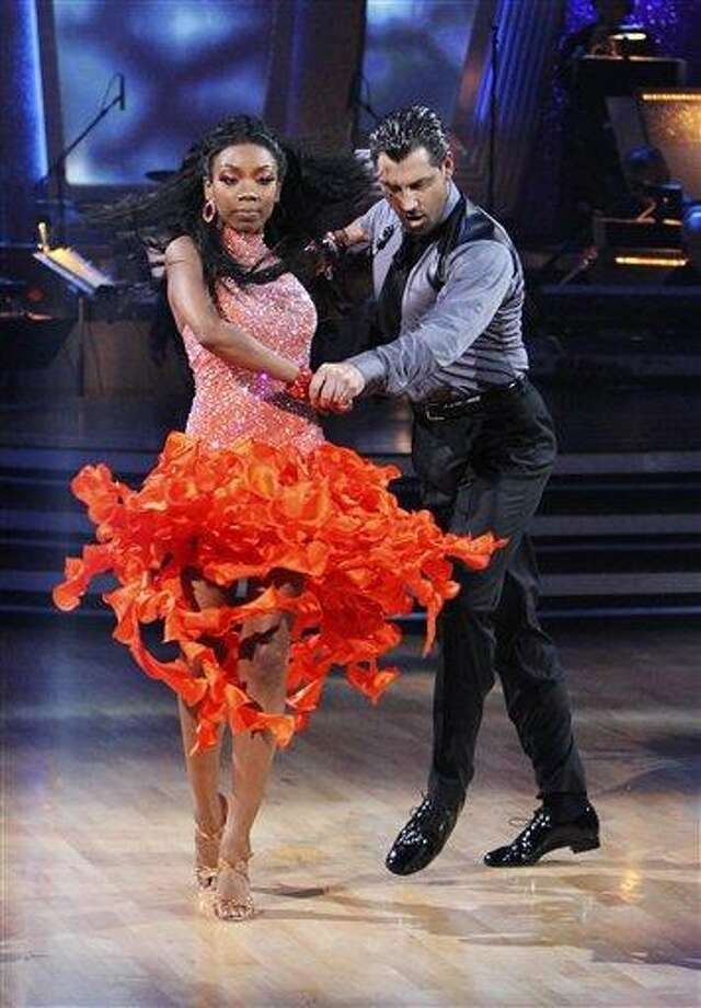 """In this publicity image released by ABC, Brandy, left, and her partner Maksim Chmerkovskiy perform on the celebrity dance competition series, """"Dancing With the Stars,"""" Monday, Oct. 4, 2010 in Los Angeles. (AP Photo/ABC, Adam Larkey) Photo: AP / © 2010 American Broadcasting Companies, Inc. All rights reserved."""