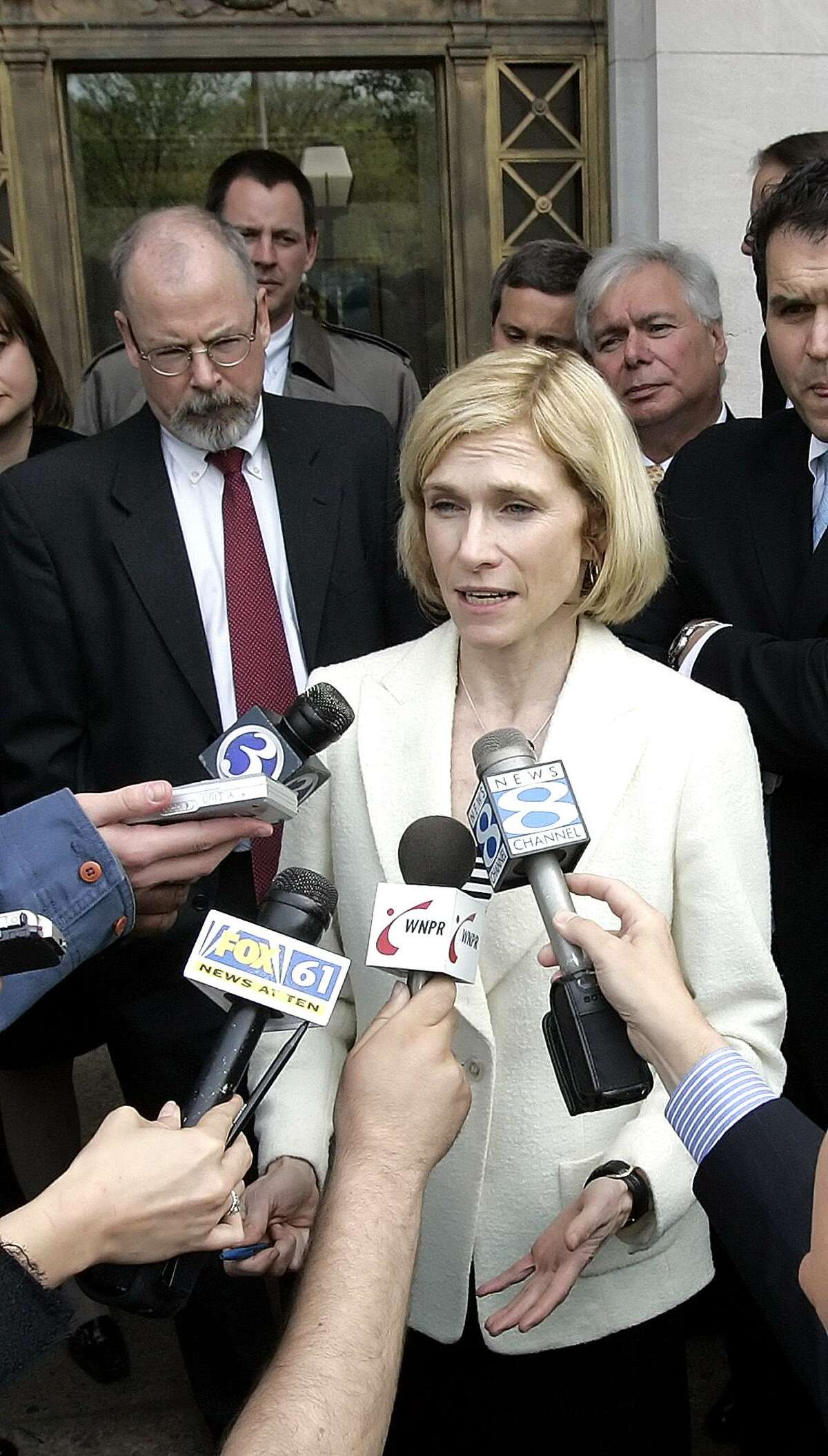 Assistant U.S. Attorney Nora Dannehy, named Connecticut deputy attorney general Friday, shown in this file photo with reporters after state contractor William Tomasso and former Connecticut Gov. John G. Rowland's Co-Chief of Staff Peter Ellef were sentenced to federal prison on corruption charges in 2006, in New Haven. (AP Photo/Bob Child)