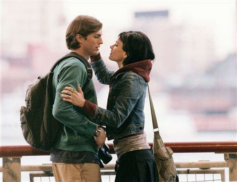 """FILE - In this 2005 file image originally released by Touchstone Pictures, Ashton Kutcher, left, and Amanda Peet are  shown in a scene from, """"A Lot Like Love.""""  (AP Photo/Touchstone Pictures/Demmie Todd, file) Photo: AP / TOUCHSTONE PICTURES"""