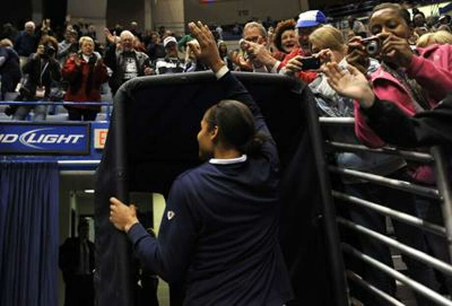 Connecticut's Maya Moore waves to fans after finishing an NCAA college basketball game against Sacred Heart in Hartford, Conn., Sunday, Dec. 5, 2010.  Moore broke the school record for all time top scorer. (AP Photo/Jessica Hill) Photo: AP / FR125654 AP