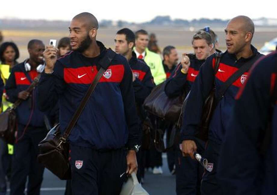 United States soccer player Oguchi Onyewu, left, and teammates arrive Monday at the O.R. Tambo International Airport in Johannesburg. The World Cup begins on June 11, the U.S. plays June 12. (Associated Press) Photo: AP / AP