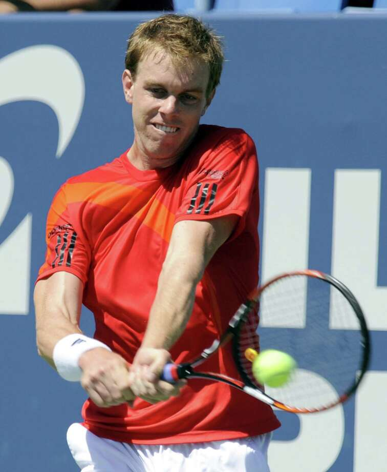 Sam Querrey of the United States, hits a backhand return to Russia's Nikolay Davydenko during the Pilot Pen Tennis tournament last year. He will be back this year.  (AP Photo/Bob Child) Photo: ASSOCIATED PRESS / AP2009