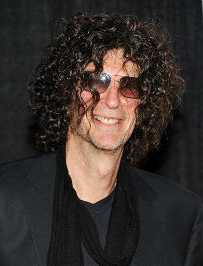 FILE - In a Dec. 1, 2010 file photo, Howard Stern attends the Quentin Tarantino Friars Club Roast at the New York Hilton Hotel in New York. Stern  announced Thursday, Dec. 9, 2010 that he has signed a new 5-year contract with SiriusXM Radio. (AP Photo/Evan Agostini) Photo: AP / AP2010