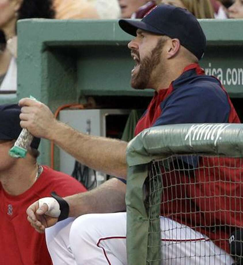 Boston's Kevin Youkilis will undergo surgery on his right hand Friday and miss the remainder of the season. (Associated Press/Elise Amendola) Photo: AP / AP