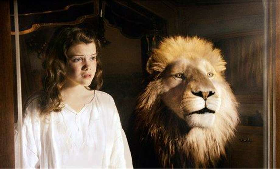 """In this film publicity image released by 20th Century Fox, Georgie Henley and Aslan the Lion are shown in a scene from, """"The Chronicles of Narnia: The Voyage of the Dawn Treader."""" (AP Photo/20th Century Fox, Phil Bray) Photo: AP / TM  & © 2010 Twentieth Century Fox Film Corporation and Walden Media, LLC.  All Rights Reserved.  Not for sale or duplication."""