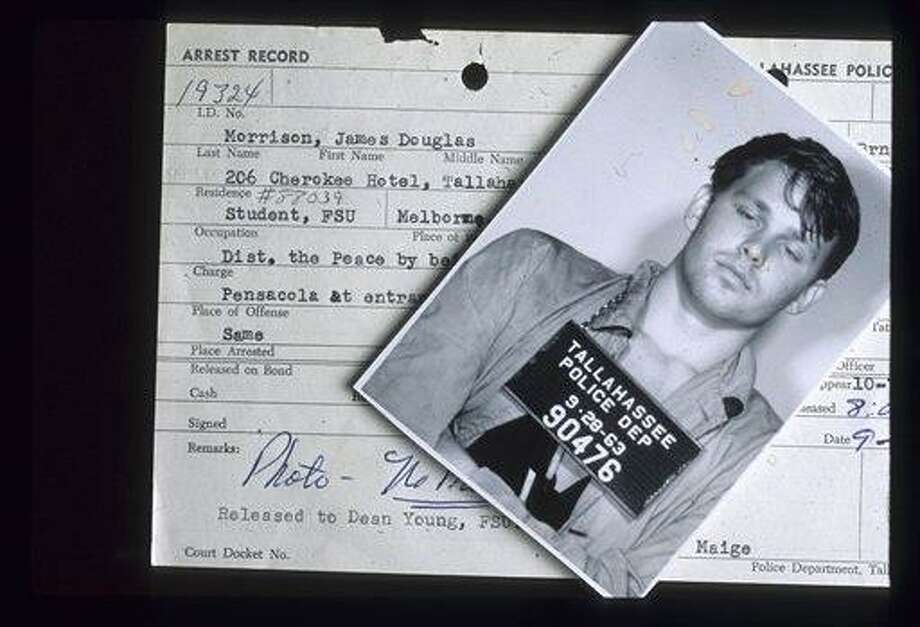 This Sept. 28, 1963 photo released by the Florida Dept of State archives, shows the arrest mug and record of singer Jim Morrison. Morrison was arrested following a football game at Florida State University. (AP Photo/Florida Dept of State)