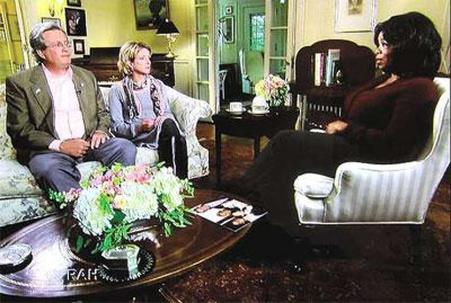 """In this image taken from Thursday's broadcast of """"The Oprah Winfrey Show"""" on WFSB,Winfrey, right, interviews Dr.William Petit Jr. and his sister, Johanna Petit Chapman. (VM Williams/Register)"""