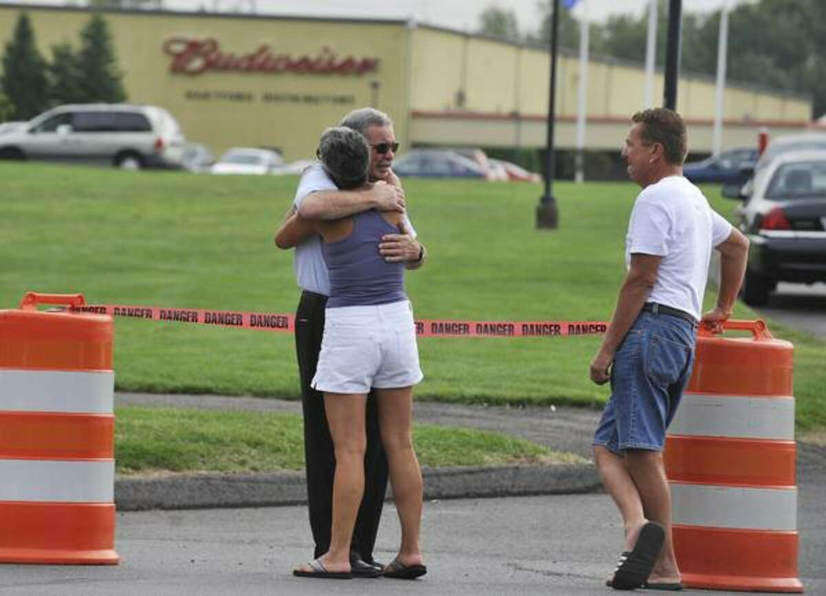 Employees and friends gather outside of Hartford Distributors in Manchester, Conn., Wednesday, Aug. 4, 2010. Omar S. Thornton, a driver for Hartford Distributors, killed eight people, plus himself at the beer distribution company in Connecticut on Tuesday morning. (AP Photo/Jessica Hill)