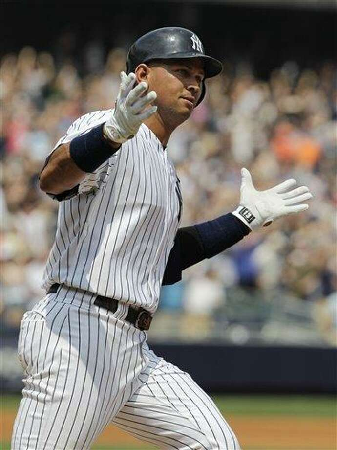 New York Yankees Alex Rodriguez reacts after hitting his 600th career home run during the first inning of a baseball game against the Toronto Blue Jays at Yankee Stadium on Wednesday, Aug. 4, 2010 in New York. (AP Photo/Kathy Willens) Photo: AP / AP
