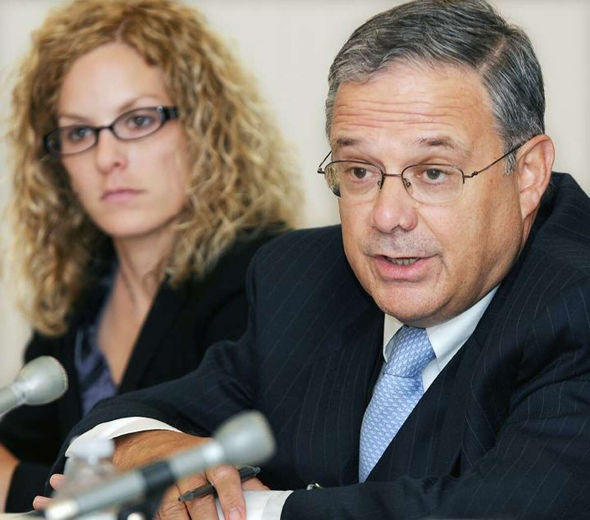 William J. Corvo, president of Kleen Energy Systems, is questioned at a public hearing about the Middletown power plant explosion held at the Public Utility Control Department in New Britain. At left is attorney Carrie Larson of Pullman and Comley, legal counsel for Kleen Energy. (Catherine Avalone, The Middletown Press)