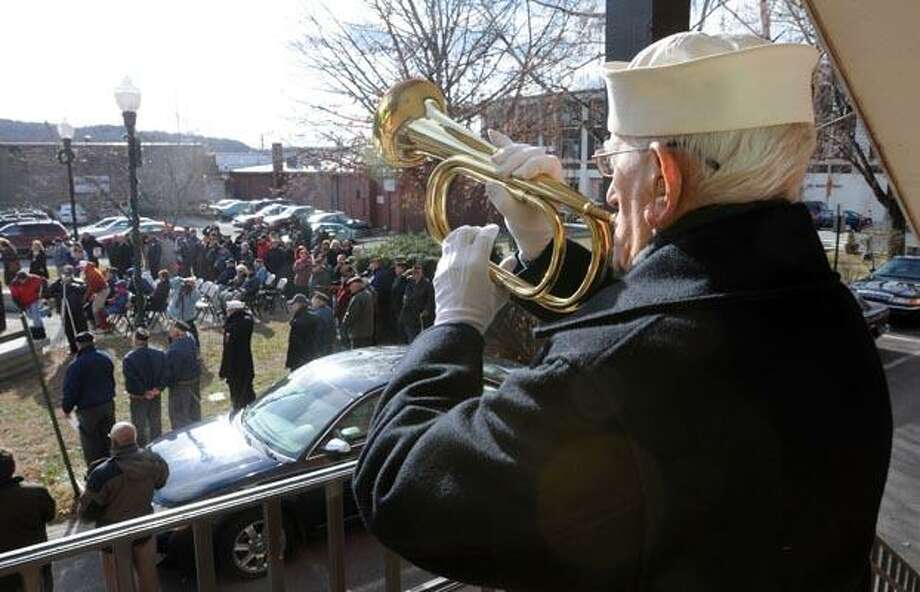 World War II Navy veteran Daniel Waleski of Derby plays taps at the Pearl Harbor Remembrance held next to Ansonia City Hall. Photo by Mara Lavitt/New Haven Register12/7/10